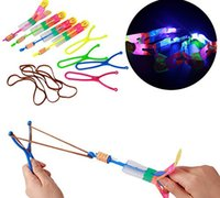 Wholesale Lighted Slingshot Helicopter - 200pcs lot Free UPS Fedex Ship Slingshot Led Light Arrow Rocket Helicopter Flying Toy Party Fun Gift Elastic (The LED Slingshot Helicopter)