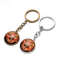 Wholesale Film Animations - The Hunger Games Mockingjay keychain Time Gem Keychain European and American animation film jewelry Retro fashion keychain 240346