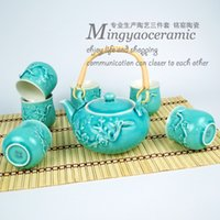 Wholesale Supply relief plum opening film Kung Fu Tea seven sets of creative cup ceramic teapot Binglie Gantry
