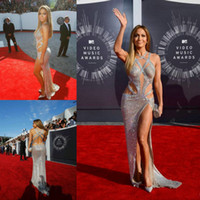 Jennifer Lopez economici lussuosi 2014 abiti da ballo sexy con criss cross cinghie spaccate paillettes backless argento celebrità abiti da red carpet