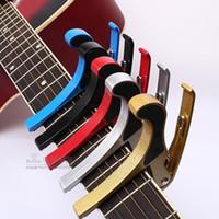 guitarra acústica capo trigger al por mayor-Tune Quick Change Trigger Folk acústico Capos Guitarra eléctrica Banjo Trigger Capo Key Clamp