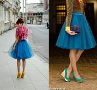 28f3389f1c vestidos de primavera de color amarillo baratas al por mayor-Las faldas  cortas amarillas azules