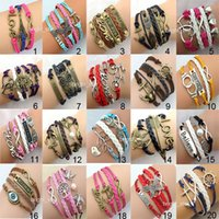 Wholesale New Designs Vintage Jewelry - Fashion Infinity Bracelets Imitated Leather Pearl Knitting Bronze Charm Bracelet Vintage Jewelry New Christmas series 148 Designs DRB001