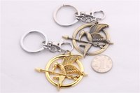 Wholesale Hunger Games Logo - Hunger Games Keychain Wee Acorn Logo Gold Laugh Birds Parrot Birds Key Chain Accessories Key Chain Movie Jewelry