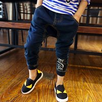 Wholesale Cool Jeans For Kids - Hot Sale New Style Boys Jeans Fashion Black Offset Printing Childrens Pants Big Cyprinoid Printed Back Cool Jeans For Kids CR130