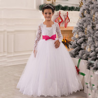 Wholesale Girls Puffy Long Pageant Dress - Princess Illusion Long Sleeves Flower Girl Dress Puffy Lace Appliques White Kids Wedding Party Dresses Pageant Gowns with Fuchsia Bow