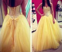 vestidos de fiesta de tul amarillo largos al por mayor-Vestido de quinceañera amarillo 2018 Vestidos de abalorios de cristal Tul sin mangas Corpiño Vestidos de fiesta largos Fiesta formal Vestidos de fiesta personalizados