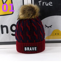Wholesale Braves Beanie - 50pcs children's winter hat label BRAVE boy and girl winter warm windproof hat 5-15 years old elastic hair ball wholesale