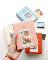 fotoalben kostenloser versand großhandel-Neuer 64 Taschen Album-Kasten-Speicher für Foto FujiFilm Instax MiniFilm Größe 4 färbt heißes sela freies Verschiffen