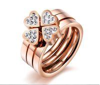 Wholesale Triple Wedding Ring Set - Mixed batch of Korean jewelry happiness Clover temperament rose gold diamond triple love titanium steel ring female