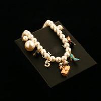 14k gold chokers großhandel-2017 nachahmung perlen halskette blumen anhänger luxus simulierte perlenkette kristall choker halskette perle arbeit schmuck für frauen