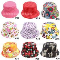 bebek bebek kovası şapka toptan satış-50pcs Sıcak Satılık Bebek Karikatür baskılı çiçek şapka kız bebek güneş şapkası Renkli Bebek Kepçe şapkaları tuval çocuklar mevcut 24 tasarım beanie kap