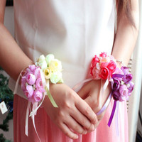 Wholesale Flower Wrist Bands - 2015 Charming Wrist Flowers Brides Wedding Bouquets Pink Purple Bridesmaid Hand Flowers Adjustable Band with Pearls and Ribbons