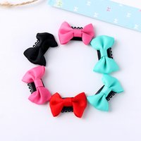 Compra Modelli Di Argilla Polimerica-Wholesale- 10 pezzi Fashion Cute Lovely Girls all'ingrosso Farfalla nodo Dot Pattern bambini Clay Polymer Party Hairpin Hair Bow Clip