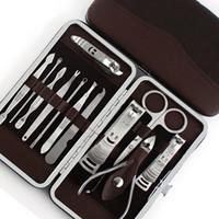 conjunto de herramientas de acero al por mayor-12pcs Set de manicura Pedicura Tijeras Pinzas Cuchillo Ear Pick Utility Kit de cortaúñas, Juego de herramientas de cuidado de uñas de acero inoxidable