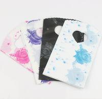 пурпурные подарочные пакеты звезд оптовых-200 шт. / лот 4 цветов розовый синий черный фиолетовый звезды розы пластиковые ювелирные изделия подарочная сумка сумки ювелирные изделия 15x9 см 112307