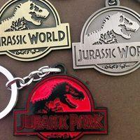 Wholesale Wholesale Jurassic Park - Promotion gift Jurassic Park keychain luxury alloy dinosaur key chains key rings badge pendants movie jewelry cardboard packaging 240206