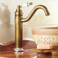 banyo musluğu antik pirinç kaplama toptan satış-Ücretsiz kargo Antik Pirinç Porselen Evye Banyo Havzası Pirinç Musluk Mikser Dokunun Döner Antik Bronz Bitirme Musluklar A-F013