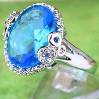 femme topaze bleue achat en gros de-2020 femmes A0068 nuptiale bijoux sonne 18x12mm strass bleu ovale coupé morganite blanc topaze pierre précieuse 18K or blanc plaqué bague taille9