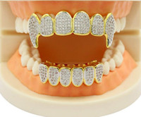 Wholesale classic party toy Shining Hip Hop GRILLZ Iced Out CZ Fang Mouth Teeth Grillz Caps Top Bottom Grill Set Men Women Vampire Grills