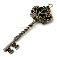 Vente en gros-Hot vendant Antique style Vintage Old Look Skeleton Key Crown Bow Steampunk Charm Accessoire Bronze