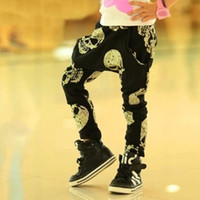 Wholesale corduroy children casual pants online - cool boy girl spring autumn Fashion Casual black Harem long Pants with gold skull hot sale children boy girl gift