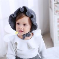 детские шапки ручной работы оптовых-Новорожденные ручной работы крючком цветы шапки ребенка шерсти шлема зимы малышей шапки мода девушки вяжут аксессуары для волос малыша капот фотографии шляпы