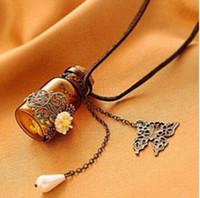 ätherische öle glas anhänger großhandel-Glasflasche Aromatherapie ätherisches Öl Diffusor Halskette Medaillon Anhänger Schmuck mit 24