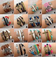 Wholesale love cross anchor infinity bracelet - Hot 20 pcs 142 designs infinity Charm Bracelets Pearl cross Double heart bird bracelets for women owl bracelets wholesale anchor bracelet
