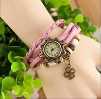 reloj de trébol de señoras al por mayor-Hot new Leather Hand Knit Relojes vintage Vestido pulsera Mujer Niñas Damas trébol colgante Retro