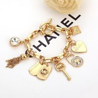 Wholesale Wholesale Mens Diamond Bracelets - Hug Me Women Mens The big big diamond rivet lock small tassel couple bracelet bracelet Charm Bracelets BB-1070