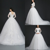 Wholesale best wedding pictures for sale - Group buy Stock Ball Gown Wedding Dresses Long Sleeves Sheer Jewel Neck Dubai Wedding Gowns with Appliques Crystal Sexy Backless Vestido de novia Best