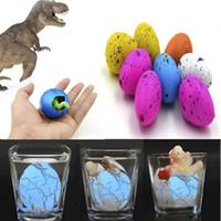 ingrosso uovo dino magico-60pcs Dinosauro magico cova gonfiabile aggiunga l'acqua che cresce le uova di Dino Bambino Kid Toy