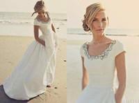 neue romantische brautkleider großhandel-2019 New Beach Brautkleider mit Taschen mit kurzen Ärmeln Scoop Crystal White Taft Günstige Romantische Boho Hochzeit Brautkleider Angepasst