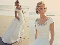 vestido de novia de tafetán al por mayor-2019 Nuevos vestidos de novia de playa con bolsillos Mangas cortas Scoop Crystal White Taffeta Vestidos de novia románticos baratos de Boho Wedding personalizados