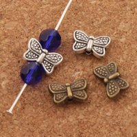 Wholesale Bronze Spacers - Dots Butterfly Charm Beads 300pcs lot 10.5x6.7mm Antique Silver Bronze Spacers Jewelry Findings L549