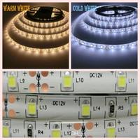 carrete luces led flexibles al por mayor-5M 10 Rollos 2835 SMD Tira de luz flexible 12V Impermeable 60LED / m 5 m / Carrete El 2835 Consumo de energía Precio más bajo que 5050