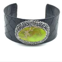 ingrosso i braccialetti della pelle di serpente-Bracciale regolabile con nuovo bracciale aperto in pietra di pitone nero sfaccettato con pietra naturale di pitone