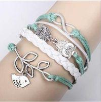 leather lucky charm bracelets großhandel-Eulen Glück Branch Leaf Schöne Vogel Charm Armband Silber Lederarmband Silber Charm Armbänder für Frauen