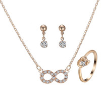 Wholesale Gold Plated Bridal Necklace Sets - 2016 Newest Gold Three-piece Bridal Jewelry Crystal Ring Earrings Imitation Gold Infinity Necklace Character Fashion Jewelry Set for Women