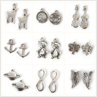 Wholesale Violin Charms - Hot Selling Fine 650pcs bag Electroplate Silver Color Butterfly Leaves Tiger Earth Violin Pendants For Women Girls Jewelry Accessories Gift