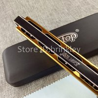 Wholesale Hardcover EASTTOP East of the most harmonica hole C silver gold professional playing harmonica