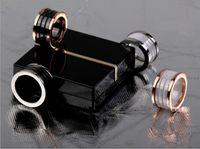 anillos de oro negro para las mujeres al por mayor-Anillos de Whorl de cerámica negro / blanco, oro amarillo / oro rosa / colores de metal plateado Acero inoxidable de titanio mujeres / joyería de hombres --- tamaño 5 a 13