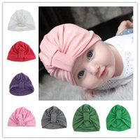 Wholesale pink knot resale online - Newborn hat Baby hats Infants twist knot hats Pink purple green cotton Solid European High quality months unisex best sell