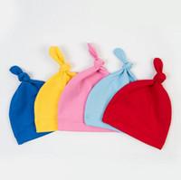 ingrosso cappelli neonati-Cappuccio di cotone solido di colore della caramella del cappello del nodo per usura di primavera della molla del bambino 2017 nuove neonate Cappelli infantili del bambino dei capretti