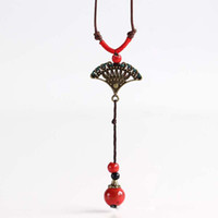 Wholesale Ceramic Jewelry Pendants - Bohemian Style Long Sweater Chain Retro Pendant Ceramic Jewelry Handmade Necklaces For Woman Gift Fashion Red Beaded Peacock Feather Shape