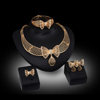 Wholesale Bowknot Rhinestone Earrings - Necklaces Earrings Bangles Rings Jewelry Sets Fashion Women Rhinestone 18K Gold Plated Hollow Out Bowknot Wedding Jewelry 4-piece Set JS047