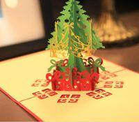 cartes de noël faites à la main achat en gros de-Cartes de voeux de Noël 3d fait main pop up cartes de voeux 3D carte de papeterie cadeau main de Noël à la main Vintage rétro percé cartes de voeux
