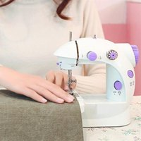 Wholesale EU US Universal Mini Household Purple Electric Sewing Machine Speed Adjustment with Light Household Double Thread Pedal Extension Table
