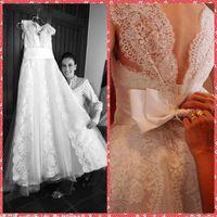 Wholesale Bowknot Applique - V-Neck Sleeveless A-Line Wedding Dresses Embroidery Lace Appliques Bridal Gowns Court Train Bowknot Adorned Back Vestidos De Novia 2016
